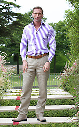Dr. Christian Jessen from Channel 4's Embarrassing Bodies  at the preview day of the RHS Hampton Court Palace flower show , Monday, 2nd July 2012.  Photo by: Stephen Lock / i-Images
