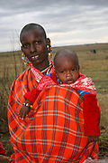 Maasai Woman with her baby. Maasai is an ethnic group of semi-nomadic people. Photographed in Tanzania