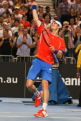© Licensed to London News Pictures. 21/01/2012. Melbourne Park, Australia. Andy Murray (GBR) punches the air in celebration in his men's singles match against Michael Llodra (FRA) during the 6th day, round 3 of the Australian Open. Photo credit : Asanka Brendon Ratnayake/LNP