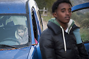 November 7, 2016,  Breil-sur-Roya, French Alpes, France. The daughter of Éloïse (L) watches Eritrean migrants her mother Eloïse picked up while they where walking on the road. Eloïse took them in her car, and will shelter them in her home for one night. Eloïse is a mother of 2 young children.<br /> <br /> 7 novembre 2016 - Breil-sur-Roya, France: La fille d'Éloïse observe des migrants érythréens que sa mère Eloïse a trouvé sur la route. Sa mère les a pris dans sa voiture pour les accueillir dans sa maison pour une nuit.