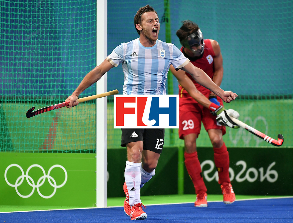 Argentina's Lucas Vila (L) celebrates his team's third goal during the men's Gold medal field hockey Belgium vs Argentina match of the Rio 2016 Olympics Games at the Olympic Hockey Centre in Rio de Janeiro on August 18, 2016. / AFP / Pascal GUYOT        (Photo credit should read PASCAL GUYOT/AFP/Getty Images)