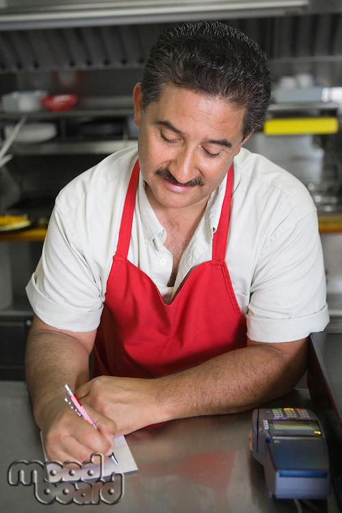 Man writing order in restaurant