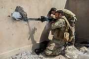 An Iraqi soldier fires on ISIS positions. West Mosul, Iraq. Apr. 19, 2017. (Photo by Gabriel Romero ©2017)