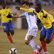 Sergio Aguero, Argentina, is challenged by Walter Ayovi, Ecuador, during the Argentina Vs Ecuador International friendly football match at MetLife Stadium, New Jersey. USA. 31st march 2015. Photo Tim Clayton