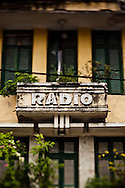 """An old French colonial style building in downtown Hanoi with """"radio"""" written on the facade, Vietnam, Southeast Asia"""