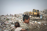 Mae Sot, Tak, Thailand - <br /> <br /> 'City Of Garbage' In Thailand<br /> <br /> Burmese refugees and garbage collectors living and working in the garbage dump site in Mae Sot, Tak, Thailand on the Thai Burma border. Tingkaya, also known as the City Of Garbage, is an area roughly the size of a football stadium. The poor inhabitants make a living selling recyclable materials like wire, metal, glass, plastic. The heap dwellers survive by eating left-overs and sleep in the same harsh environment which is a breeding ground for bacteria and diseases. <br /> ©Exclusivepix