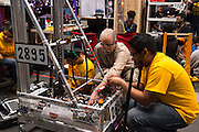 March 13, 2015 - New York, NY. Students put the finishing touches on their robot at the FIRST Robotics New York City Regional Competition at the Jacob Javits Center. 03/13/2015 Photograph by Allegra Abramo