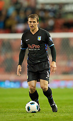 STOKE, ENGLAND - Monday, September 13, 2010: Aston Villa's Stephen Warnock in action against Stoke City during the Premiership match at the Britannia Stadium. (Photo by David Rawcliffe/Propaganda)