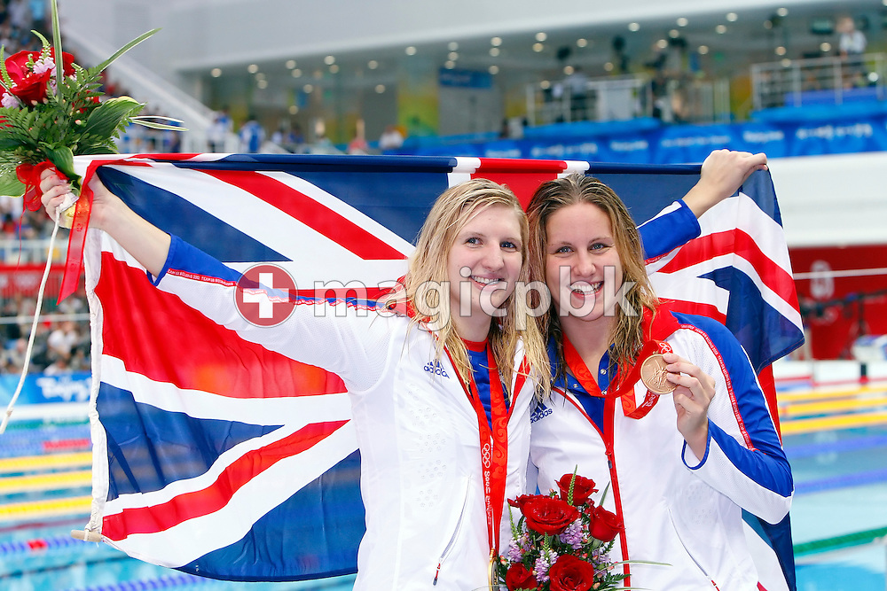Winner Rebecca ADLINGTON (L) and third placed Joanne JACKSON (R) of Great Britain pose with their medals and a Union Jack (Union Flag) after the award ceremony for the women's 400m freestyle final at the National Aquatics Center at the Beijing 2008 Olympic Games in Beijing, China, Monday, Aug. 11, 2008. (Photo by Patrick B. Kraemer / MAGICPBK)