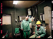 Ernie Mosley, discusses with Mike Suda, 51,of East Chicago, what things went on during his shift at the scarffer unit. Mosley, works a very inconsistent schedule, often pulling midnights from 10 o'clock p.m. to 6: 30 a.m. or doing days from 6: 30 a.m. until 2:30 p.m.