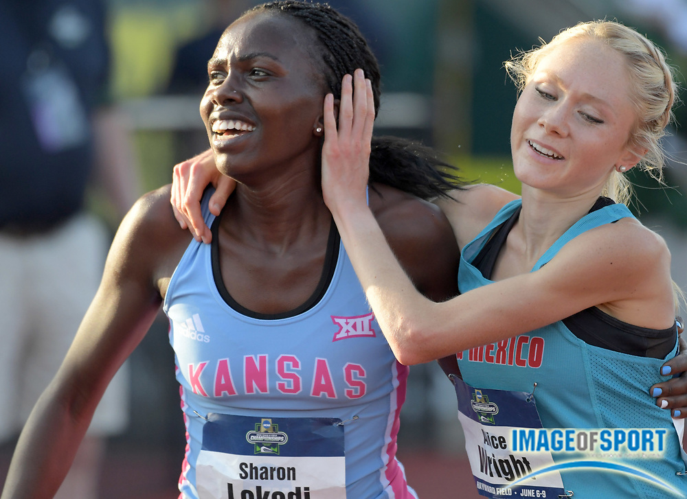 Jun 7, 2018; Eugene, OR, USA; Sharon Lokedi of Kansas (left) celebrates with Alice Wright of New Mexico after winning the women's 10,000m in a meet record 32:09.20 during the NCAA Track and Field championships at Hayward Field.