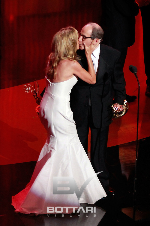 Executive producer Harry Friedman accepts the Outstanding Game/Audience Participation Show award onstage while receiving a kiss from Vanna White during the Daytime Emmy Awards on Sunday June 19, 2011 in Las Vegas. (AP Photo/Jeff Bottari)