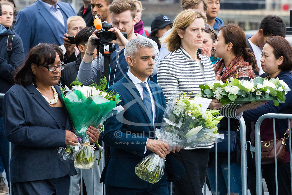 City Hall, London, June 5th 2017.  Shadow Home Secretary Dianne Abbott MP, Mayor of London Sadiq Khan and Home Secretary Amber Rudd MP arrive with flowers to be laid at a vigil held in remembrance of those killed during the June 3rd terror attack at London Bridge and Borough Market.