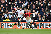 Derby County midfielder Jamie Hanson pulls the shirt of Nottingham Forest midfielder Ben Osborn during the Sky Bet Championship match between Derby County and Nottingham Forest at the iPro Stadium, Derby, England on 19 March 2016. Photo by Jon Hobley.