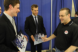 Andy Agostini, Associate Producer at Electronic Arts presents screen shots from EA Sports NHL 11 to Tyler Seguin (left) of the Plymouth Whalers and Taylor Hall of the Windsor Spitfires at the Canadian Hockey League media conference at the MasterCard Memorial Cup in Brandon, MB on Friday. Photo by Aaron Bell/CHL Images