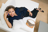 Woman Using Cell Phone on Sofa
