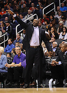 Dec. 17, 2012; Phoenix, AZ, USA; Sacramento Kings head coach Keith Smart reacts from the sidelines during the game against the Phoenix Suns in the first half at US Airways Center. Mandatory Credit: Jennifer Stewart-USA TODAY Sports.