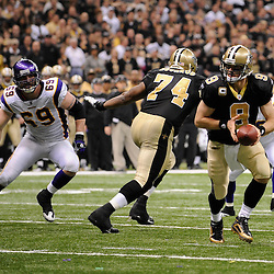 Jan 24, 2010; New Orleans, LA, USA; New Orleans Saints quarterback Drew Brees (9) looks to hand off as Minnesota Vikings defensive end Jared Allen (69) rushes in during a 31-28 overtime victory by the New Orleans Saints over the Minnesota Vikings in the 2010 NFC Championship game at the Louisiana Superdome. Mandatory Credit: Derick E. Hingle-US PRESSWIRE