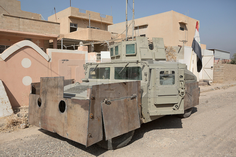 Licensed to London News Pictures. 23/10/2016. A Humvee utility vehicle, modified with extra armour by its former Islamic State owners, is seen on a street whilst it waits repairs by the Iraqi Army in the recently liberated town of Bartella, Iraq.<br /> <br /> Bartella, a mainly Christian town with a population of around 30,000 people before being taken by the Islamic State in August 2014, was captured two days ago by the Iraqi Army's Counter Terrorism force as part of the ongoing offensive to retake Mosul. Although ISIS militants were pushed back a large amount of improvised explosive devices are still being found in the town's buildings. Photo credit: Matt Cetti-Roberts/LNP