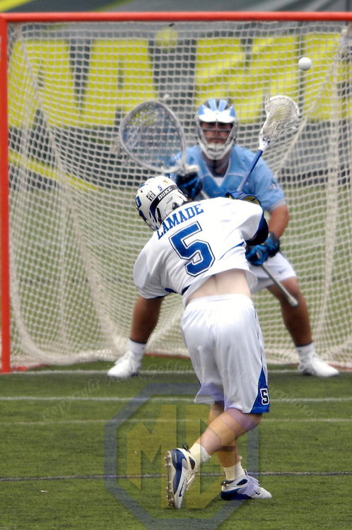 28 May 2007: Duke University mid fielder Peter Lamade (5) scores a goal in the 2nd quarter against Johns Hopkins goal keeper Jesse Schwartzman (2) in the NCAA Division I Lacrosse Championship game.  The Johns Hopkins Blue Jays defeated the Duke Blue Devils 12-11 to win the NCAA Division I Lacrosse championship at M&T Bank Stadium in Baltimore, Md. .