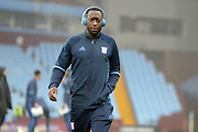 Ipswich Town midfielder Toumani Diagouraga (37) listens to Beats headphones during the EFL Sky Bet Championship match between Aston Villa and Ipswich Town at Villa Park, Birmingham, England on 11 February 2017. Photo by Alan Franklin.