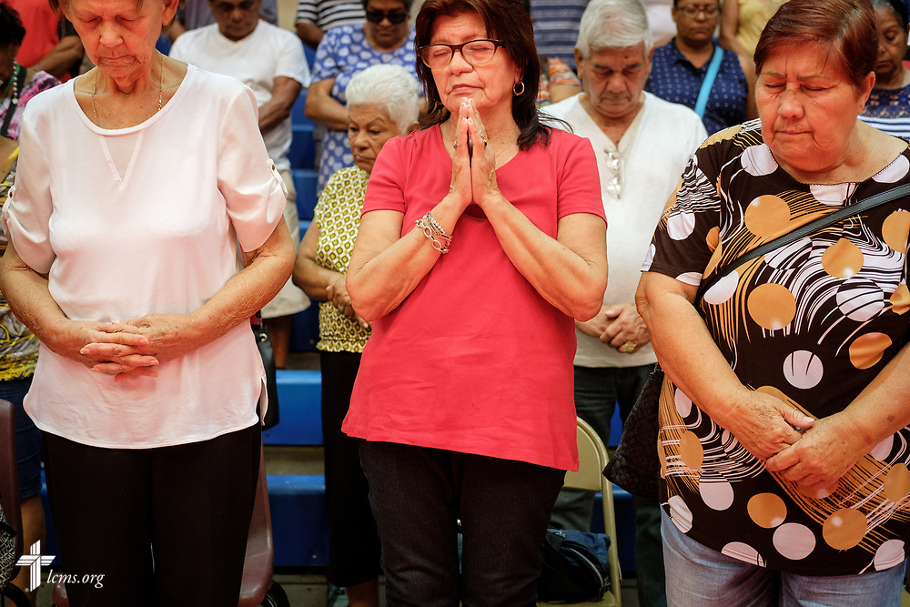 Residents at a local community center pray before a food distribution event on Tuesday, April 17, 2018 in Mayagüez, Puerto Rico. LCMS Communications/Erik M. Lunsford