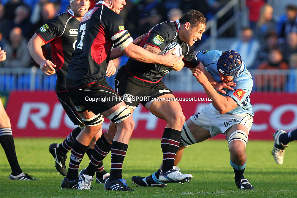 Harbour's Luke McAlister fends off Northland's Cameron Eyre. ITM Cup rugby union match, Northland v North Harbour at Northland Events Centre Toll Stadium, Whangarei, New Zealand. Sunday 8th August 2010. Photo: Anthony Au-Yeung/PHOTOSPORT