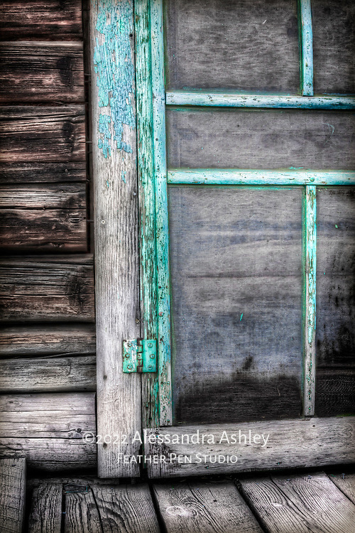 Screen door of antique barn adjacent to historic pink house on Mormon Row.  Grand Teton National Park, Jackson Hole, Wyoming.