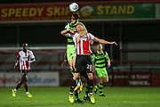 Forest Green Rovers Alexander Lacovitti(20) out jumps Cheltenham Town's Taylor Moore(28) during the EFL Trophy match between Cheltenham Town and Forest Green Rovers at Whaddon Road, Cheltenham, England on 3 October 2017. Photo by Shane Healey.