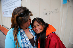 "Rita Acosta, left, comforts Lucy Soto, known as ""Shorty,"" in front of her spot in a doorway on Soledad Street. Shorty is 54 years old, and has lived in Salinas since 1964. She was distraught at having lost much of what she needs to keep warm during the sweep."