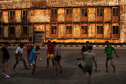 playing Chinlone in Mawlamyaing, Myanmar.