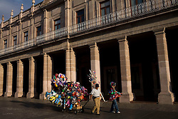 A man sells balloons to tourists in downtown Aguascalientes.