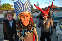 "MEXICO, Veracruz, Tantoyuca, Nov 1- Nov 4, 2009. Making the souls of the dead feel welcome as they return for a yearly visit, Mexicans in this tropical state offer not only elaborate feasts and flower-filled altars, but dancing as well. Masked bands of performers called ""cuadrillos"" rehearse for months their choreography, rich with symbolic roles for men, women, devils, and death itself, then over the course of two nights regale both graveyards and city streets with whoops of laughter, raise-the-roof dancing and music until dawn. Photographs for HOY by Jay Dunn."