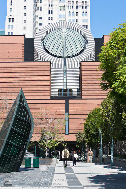 "San Francisco Museum of Modern Art and people walking past Seasons of the Sea ""Adrift"" .by John Roloff"