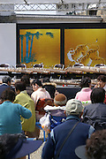 A Japanese audience waiting to view a performance of koto, a Japanese stringed instrument.