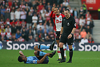 Football - 2017 / 2018 Premier League - Southampton vs. Newcastle United<br /> <br /> Southampton's Virgil van Dijk signals to Referee Mr Kevin Friend that that was Isaac Hayden of Newcastle United second offence at St Mary's Stadium Southampton<br /> <br /> COLORSPORT/SHAUN BOGGUST