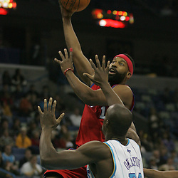 Jan 13, 2010; New Orleans, LA, USA; Los Angeles Clippers guard Baron Davis (1) shoots over New Orleans Hornets center Emeka Okafor (50) during the first quarter at the New Orleans Arena. Mandatory Credit: Derick E. Hingle-US PRESSWIRE