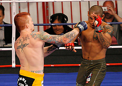 August 2, 2007; East Rutherford, NJ, USA; The Silverbacks Bart Palaszewski (Yellow Trunks) defeats the Anacondas Harris Sarmiento (Green Trunks) via rear naked choke in the third round of their semifinal bout at the Continental Airlines Arena in East Rutherford, NJ.