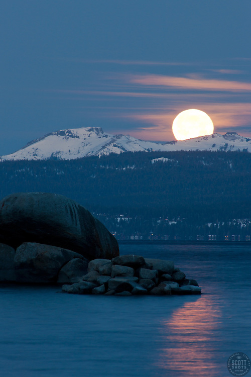 """""""Full Moon Setting Over Tahoe 1"""" - Photograph shot from Sand Harbor of a full moon setting in the early morning over Lake Tahoe, Nevada."""