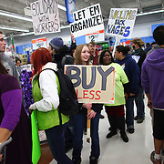 Protesters march through Walmart in Renton during an Occupy Seattle protest at the retailer on Friday, November 25, 2011. A few dozen protesters gathered in front of the store and briefly marched through the store during the Black Friday protest. (Joshua Trujillo, seattlepi.com)