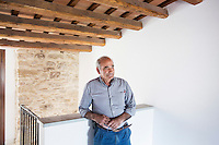 GANGI, ITALY - 30 MAY 2015: Salvatore Bonomo, a local carpenter, is here in one of the houses he has restore in the historical center of Gangi, Italy, on May 30th 2015. Gangi is a town with a population of 7,000 between Palermo and Catania, in the centre of Sicily, whose local administration is giving away abandoned houses of the historical centre for free. The Mayor of Gangi Giuseppe Ferrarello conceived the initiative of giving houses for free as a means to diversify the local economy - primarily dependent on agriculture and animal husbandry - by boosting tourism-related activities, and consequently counteract the phenomenon of depopulation that is typical of many small Italian towns where employment possibilities have been on a downward trajectory for years. The renovations of the assigned homes have also given work to local artisans.