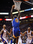 Apr 5, 2013; Phoenix, AZ, USA; Golden State Warriors center Festus Ezeli (31) dunks the ball as the Phoenix Suns forward Markieff Morris (11) and forward Wesley Johnson (2) watch on in the first half at US Airways Center. Mandatory Credit: Jennifer Stewart-USA TODAY Sports