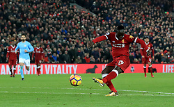 Liverpool's Sadio Mane scores his side's third goal of the game during the Premier League match at Anfield, Liverpool.