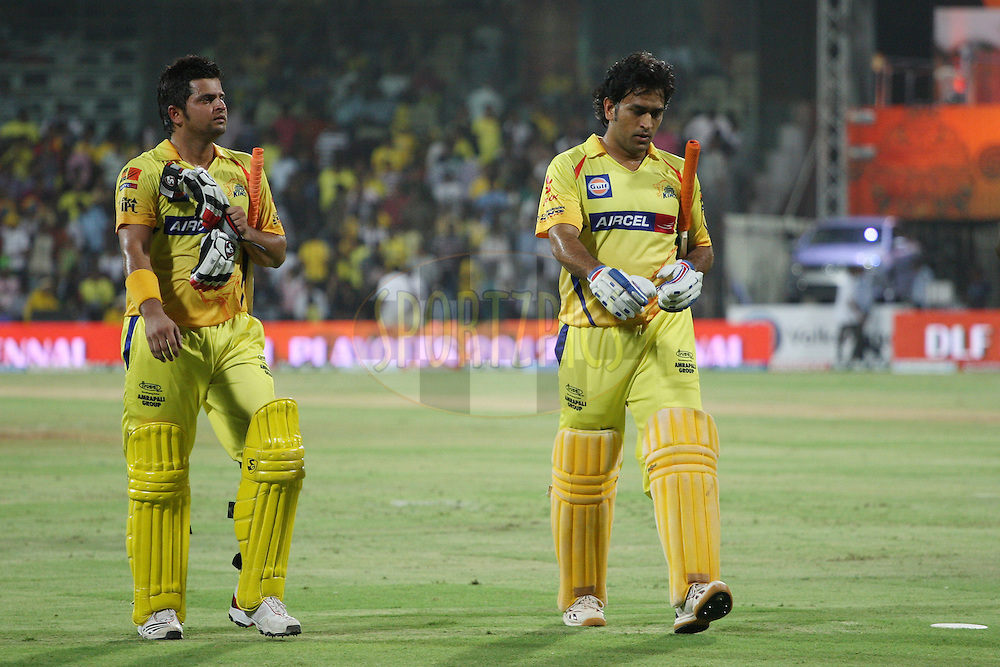 Suresh Raina and MS Dhoni walking off the field after their innings during the final of the Indian Premier League ( IPL ) 2012  between The Kolkata Knight Riders and the Chennai Superkings held at the M. A. Chidambaram Stadium, Chennai on the 27th May 2012..Photo by Jacques Rossouw/IPL/SPORTZPICS