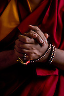 The Mala beads worn by Geshe Lozang Samdup who was born in Nubra Chakrasa, Ladakh in the north of India in the year 1962. He was then called Samdup Wangdue. At the age of 13, he joined the Buddhist Order in Nubra Dekit Monastery under the abbotship of Ven. Lobzang Tsephel, from whom he received his preliminary and novice vows. He was given the novice name Lobzang Samdup. He passed through the monastic trainings, memorizing the scriptures successfully. In the 1980, having joined Drepung Gomang Monastic University, he started his formal studies in Buddhist philosophy under the tutorship of the former abbot of the Monastery, The most Venerable Khensur Lobsang Tenpa. He studied all the five major scriptural texts that the Monastic University offers; Logic and Syllogism, Perfection of Wisdom, the Middle Way view, Abhidharmakosh and Vinaya Ethics. In 1982, during His Holiness the Dalai Lama's visit to Ganden Monastic University, which was founded by Lama Tsongkhapa, he received his full ordination vows from His Holiness.   (Photo by Robert Falcetti). .