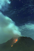 KARO, INDONESIA - APRIL 02: <br /> <br /> stunning views of Mount Sinabung Volcano as it Erupts In Indonesia<br /> <br /> A view of spewing pyroclastic flow from Mount Sinabung volcano eruption seen from Tiga Pancur village on JApril 01, 2015 in Karo, North Sumatra, Indonesia. Mount Sinabung volcanic ash up to 3,5 km from the summit. <br /> ©Tibt Nangin /Exclusivepix Media