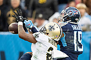 NASHVILLE, TN - DECEMBER 22:  Patrick Robinson #21 of the New Orleans Saints knocks away a pass thrown to Tajae Sharpe #19 of the Tennessee Titans at Nissan Stadium on December 22, 2019 in Nashville, Tennessee. The Saints defeated the Titans 38-28.  (Photo by Wesley Hitt/Getty Images) *** Local Caption *** Patrick Robinson; Tajae Sharpe