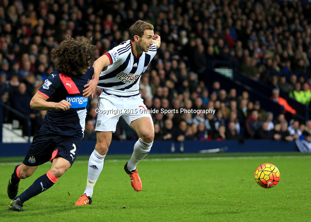 28th December 2015 - Barclays Premier League - West Bromwich Albion v Newcastle United - Craig Dawson of West Bromwich Albion shrugs off Fabricio Coloccini of Newcastle United - Photo: Paul Roberts / Offside.