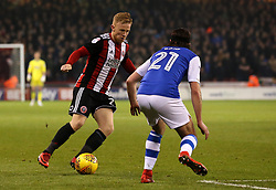 Mark Duffy of Sheffield United takes on George Boyd of Sheffield Wednesday - Mandatory by-line: Robbie Stephenson/JMP - 12/01/2018 - FOOTBALL - Bramall Lane - Sheffield, England - Sheffield United v Sheffield Wednesday - Sky Bet Championship