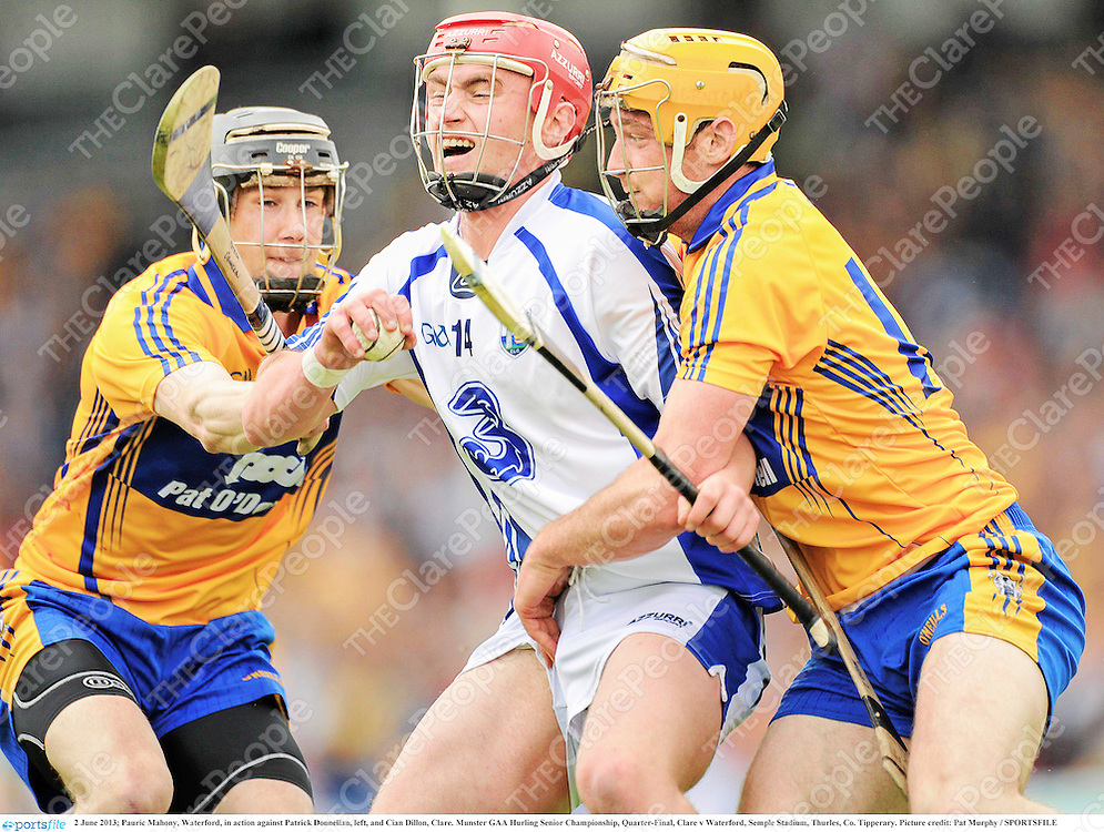 2 June 2013; Pauric Mahony, Waterford, in action against Patrick Donnellan, left, and Cian Dillon, Clare. Munster GAA Hurling Senior Championship, Quarter-Final, Clare v Waterford, Semple Stadium, Thurles, Co. Tipperary. Picture credit: Pat Murphy / SPORTSFILE